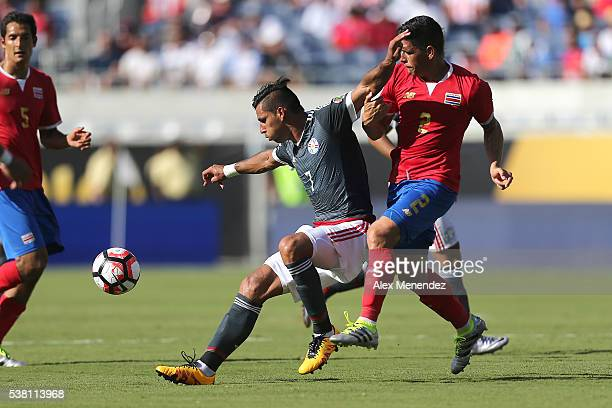 Jorge Benitez of Paraguay and Johnny Acosta of Costa Rica chase after the ball during the 2016 Copa America Centenario Group A match between Costa...