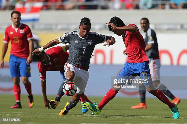 Jorge Benitez of Paraguay and Yeltsin Tejeda of Costa Rica are seen during the 2016 Copa America Centenario Group A match between Costa Rica and...
