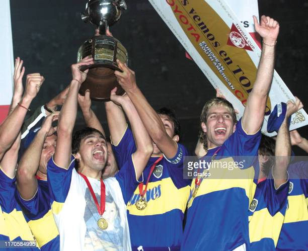 Jorge Bermúdez and Martin Palermo of Boca Juniors celebrate with the trophy at the end of the second leg final match between Palmeiras and Boca...