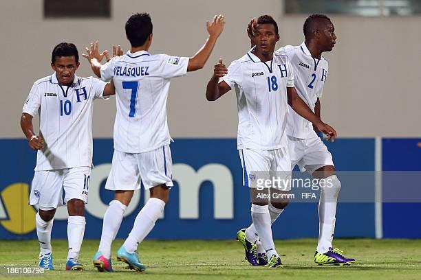 Jorge Bodden of Honduras celebrates his team's first goal with team mates Isaac Borjas Brayan Velasquez and Kevin Alvarez during the FIFA U17 World...