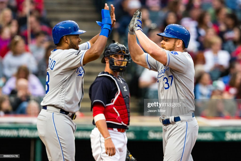 Jorge Bonifacio #38 celebrates with Brandon Moss #37 of the Kansas City Royals as Yan Gomes #7 of the Cleveland Indians watches after Moss hit a three run home run during the fourth inning at Progressive Field on May 26, 2017 in Cleveland, Ohio.