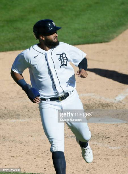 Jorge Bonifacio of the Detroit Tigers scores against the Cleveland Indians on a double by Niko Goodrum during the ninth inning at Comerica Park on...
