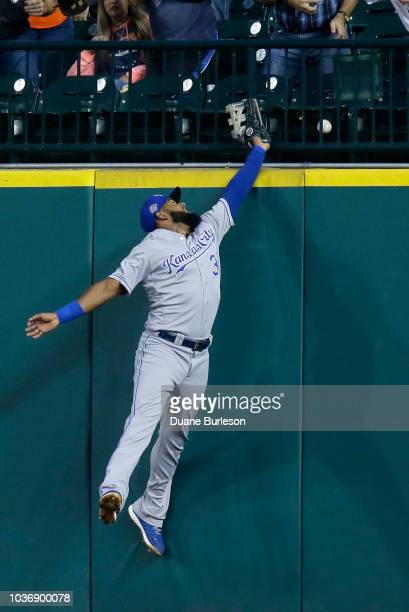 Whit Merrifield of the Kansas City Royals beats the tag from third baseman Ronny Rodriguez of the Detroit Tigers to steal third base during the first...