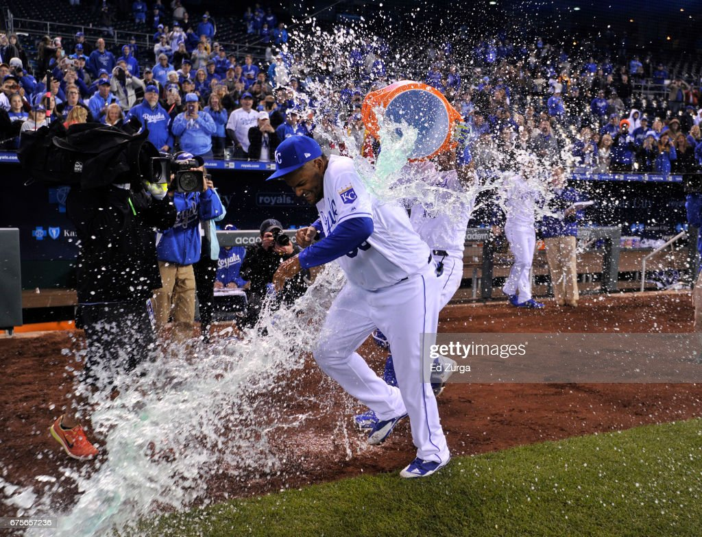 Jorge Bonifacio #38 of the Kansas City Royals is doused with Gatorade by Salvador Perez #13 as they celebrate a 6-1 win over the Chicago White Sox and snapping a nine losing streak at Kauffman Stadium on May 1, 2017 in Kansas City, Missouri.