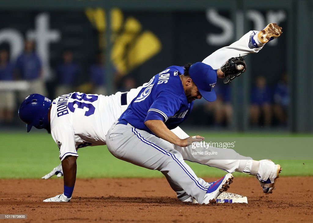 Jorge Bonifacio #38 of the Kansas City Royals is tagged out by Devon Travis #29 of the Toronto Blue Jays while attempting to turn a base hit into a double during the 2nd inningof the game at Kauffman Stadium on August 16, 2018 in Kansas City, Missouri.