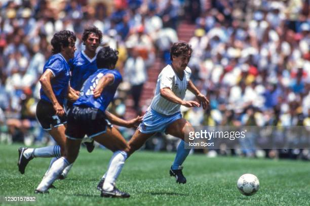 Jorge Burruchaga of Argentina and Kenny Sansom of England during the Quarter-Final FIFA World Cup 1986 match between Argentina and England, at...