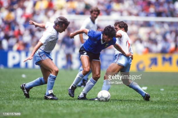 Jorge Burruchaga of Argentina and Peter Reid, Kenny Sansom of England during the Quarter-Final FIFA World Cup 1986 match between Argentina and...