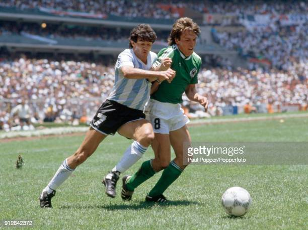 Jorge Burruchaga of Argentina challenges West Germany's Lothar Matthaus during the FIFA World Cup Final between Argentina and West Germany at the...