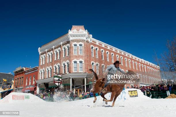Jorge Calzadillas races down Harrison Avenue on his horse Flor while pulling skier Duffy Counsel during the 70th annual Leadville Ski Joring weekend...