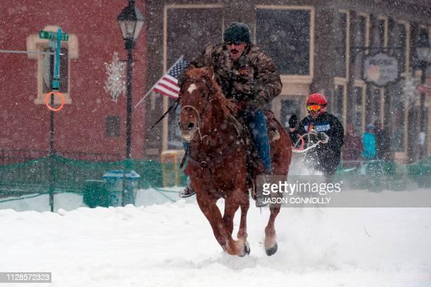 Jorge Calzadillas races down Harrison Avenue while skier Mike Tinkle navigates the Leadville ski joring course during the 71st annual Leadville Ski...