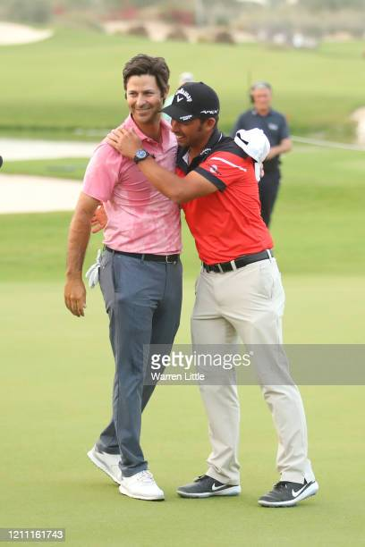 Jorge Campillo of Spain is congratulated by Pablo Larrazabal of Spain during Day 4 of the Commercial Bank Qatar Masters at Education City Golf Club...