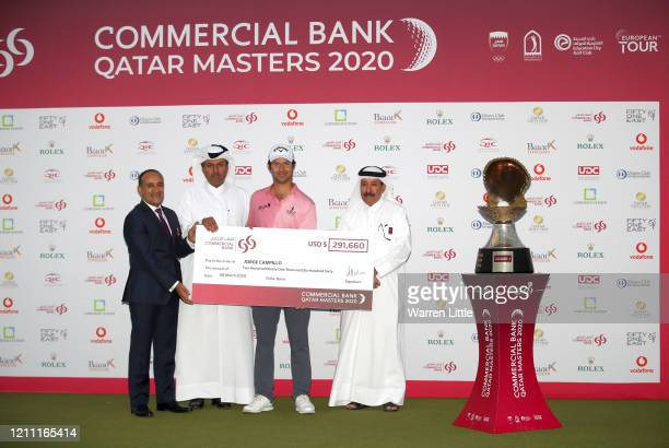 Jorge Campillo of Spain is presented with the trophy by Hassan Nasser Al Naimi President of the Qatar Golf Association and Joseph Abraham Group Chief...