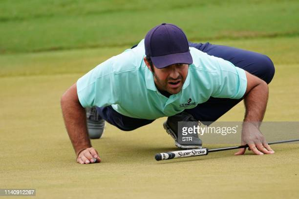 TOPSHOT Jorge Campillo of Spain lines up a putt during the second round of the China Open golf tournament in Shenzhen in China's southern Guangdong...