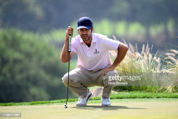 Jorge Campillo of Spain lines up a putt on the 17th green during round one of the Hero Indian Open at the DLF Golf Country Club on March 28 2019 in...