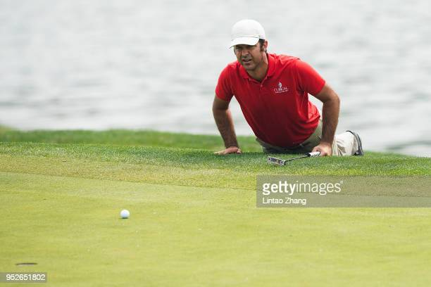 Jorge Campillo of Spain lines up a putt on the 9th hole during the final round of the 2018 Volvo China Open at Topwin Golf and Country Club on April...