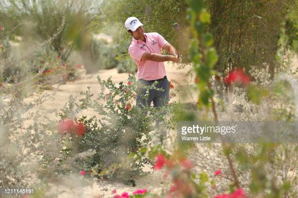 Jorge Campillo of Spain plays his second shot on the 17th hole during Day 4 of the Commercial Bank Qatar Masters at Education City Golf Club on March...