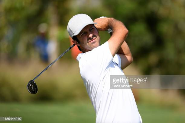Jorge Campillo of Spain plays his second shot on the 18th hole during the final round on day four of the Hero Indian Open at the DLF Golf Country...