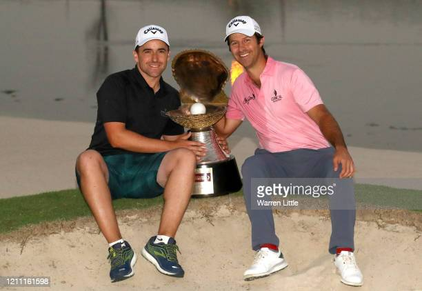 Jorge Campillo of Spain poses for a photograph with the trophy following victory during Day 4 of the Commercial Bank Qatar Masters at Education City...