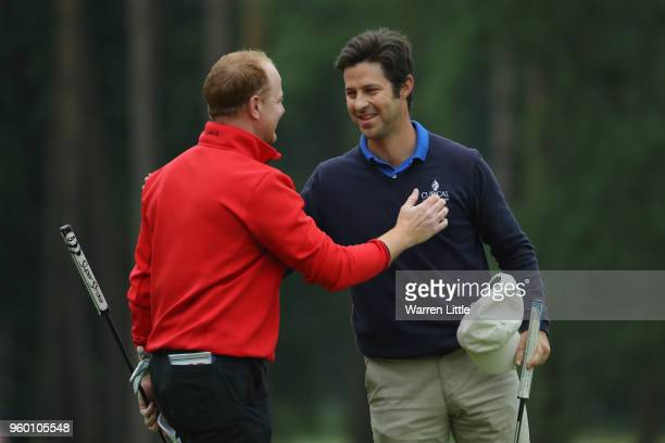 Jorge Campillo of Spain shakes hands with Richard Mcevoy of England on the 18th green during the knockout stage on day three of the Belgian Knockout...