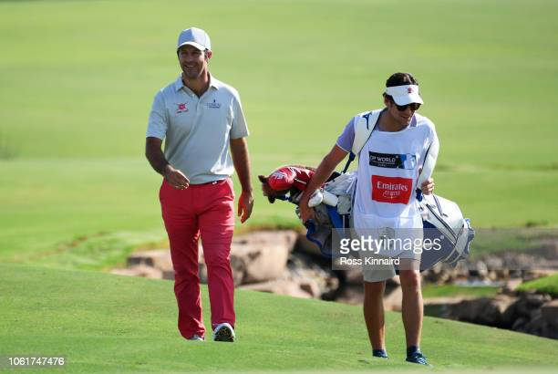 Jorge Campillo of Spain walks alongside his caddie during day one of the DP World Tour Championship at Jumeirah Golf Estates on November 15 2018 in...
