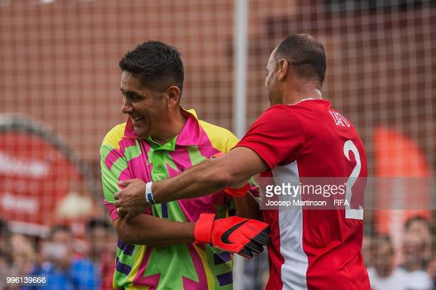 Jorge Campos interacts with Cafu during the Legends Football Match in Red Square on July 11 2018 in Moscow Russia