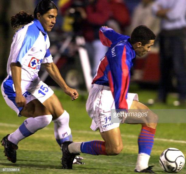 Jorge Campos of Cerro Porteno of Paraguay is blocking Francisco Palencia of Cruz Azul of Mexico 10 May 2001 in Asuncion Paraguay in part of the...