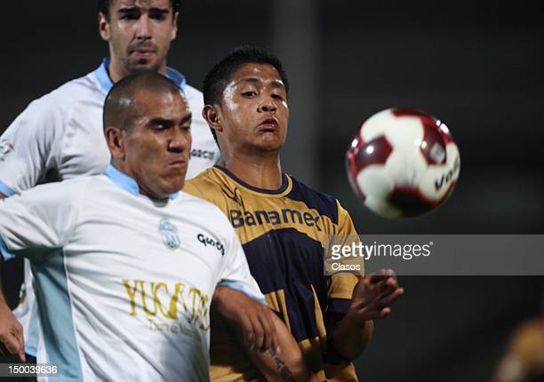 Jorge Campos of Merida fights for the ball with Daniel Ramirez of Pumas during a match between Pumas and Merida as part of the Copa MX 2012 at...