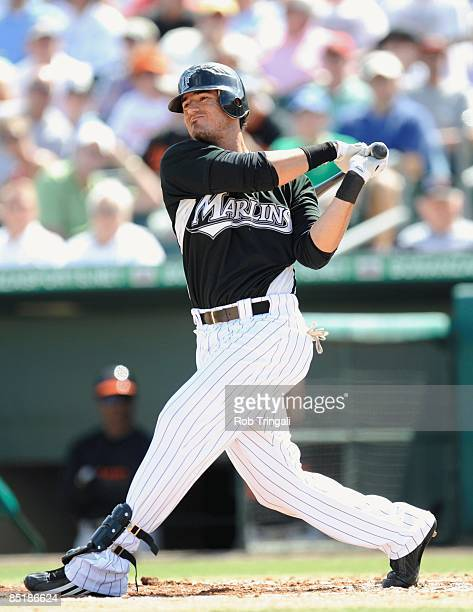 Jorge Cantu of the Florida Marlins bats against the Baltimore Orioles during a spring training game at Roger Dean Stadium on February 27 2009 in...