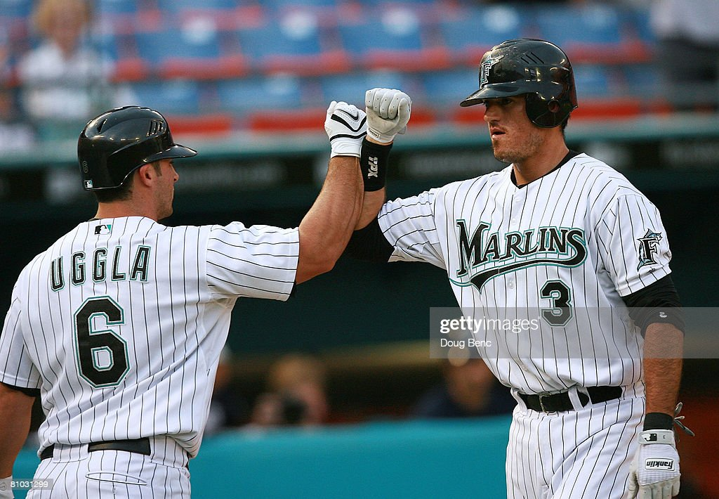 Jorge Cantu #3 of the Florida Marlins is congratulated by Dan Uggla #6 after Cantu hit a two-run home run in the first inning against the Milwaukee Brewers at Dolphin Stadium on May 8, 2008 in Miami, Florida.