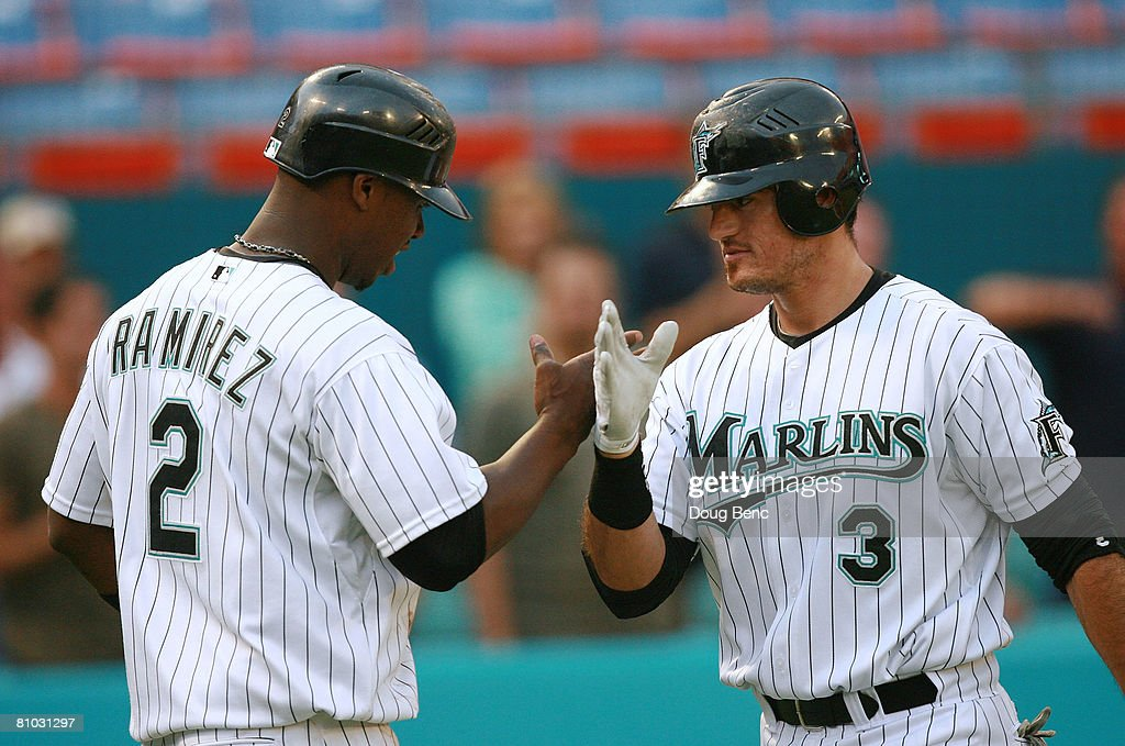 Jorge Cantu #3 of the Florida Marlins is congratulated by Hanley Ramirez #2 after Cantu hit a two-run home run in the first inning against the Milwaukee Brewers at Dolphin Stadium on May 8, 2008 in Miami, Florida.