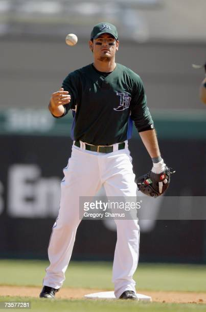 Jorge Cantu of the Tampa Bay Devil Rays tosses the ball during a spring training game against the Cincinnati Reds March 6, 2007 at Progress Energy...