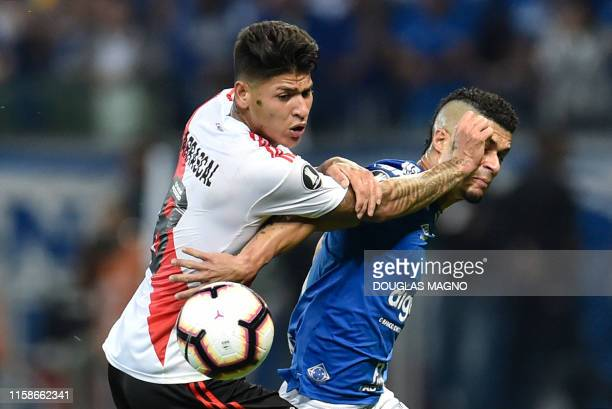Jorge Carrascal of Argentina's River Plate and Egidio of Brazil's Cruzeiro vies for the ball during their Copa Libertadores football match at...