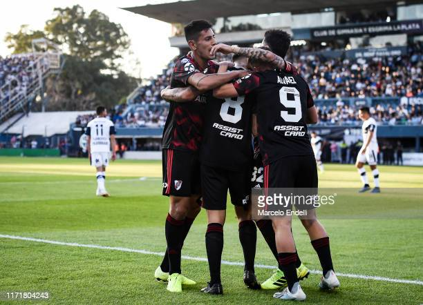 Jorge Carrascal of River Plate celebrates after scoring the first goal of his team with teammates during a match between Gimnasia y Esgrima La Plata...