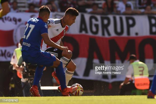 Jorge Carrascal of River Plate competes for the ball with Agustin Cardozo of Tigre during a match between River Plate and Tigre as part of Superliga...