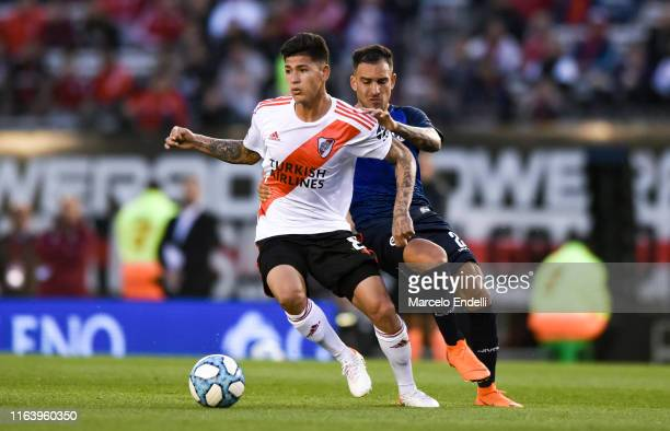 Jorge Carrascal of River Plate fights for the ball with Jonathan Menendez of Talleres during a match between River Plate and Talleres as part of...