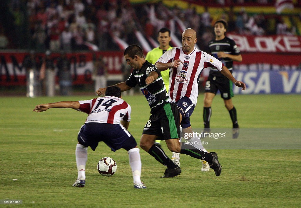 Jorge Casanova (L) of Colombia's Junior figths for the ball with Mauricio Cauteruccio of Uruguay's Racing during their match as part of the Santander Libertadores Cup 2010 at Metropolitano Roberto Melendez Stadium on January 28, 2010 in Barranquilla, Colombia.