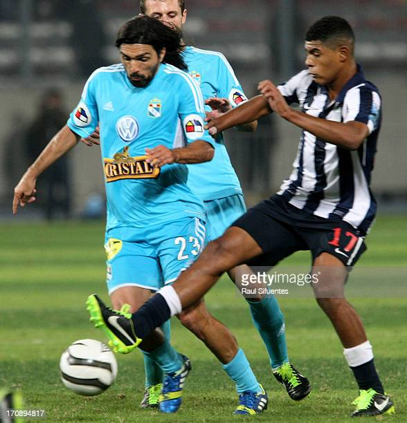Jorge Cazulo of Sporting Cristal fights for the ball with Wilder Cartagena of Alianza Lima during a match between Sporting Cristal and Alianza Lima...
