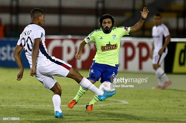 Jorge Cazulo of Sporting Cristal struggles for the ball with Wilder Cartagena of San Martin during a match between San Martin and Sporting Cristal as...
