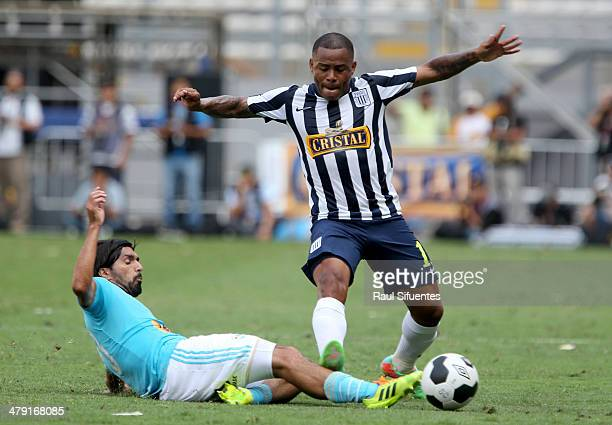 Jorge Cazulo of Sporting Cristal struggles for the ball with Wilmer Aguirre of Alianza Lima during a match between Sporting Cristal and Alianza Lima...