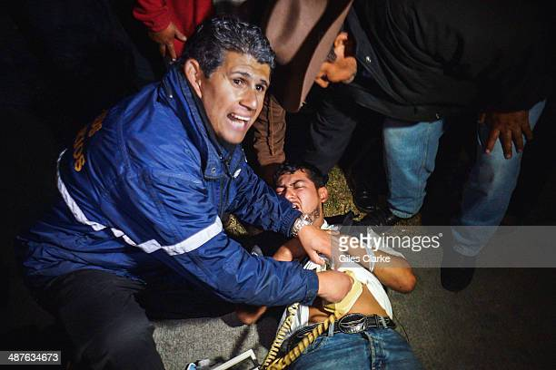 Jorge Chiu the only fully qualified doctor and firefighter in the bomberos voluntarios tends to a patient January 17 2014 in Guatemala City Guatemala...