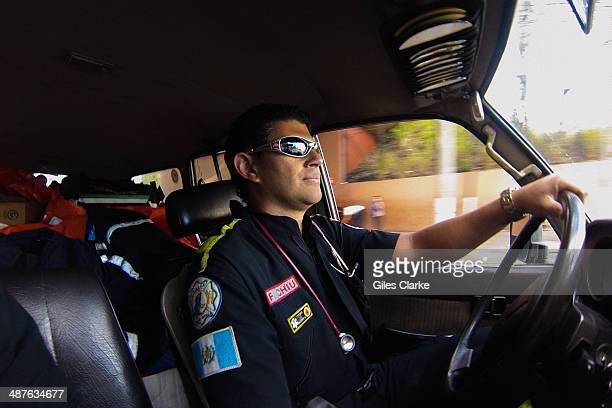 Jorge Chiu the only fully qualified doctor and firefighter in the bomberos voluntarios drives an ambulance truck January 18 2014 in Guatemala City...