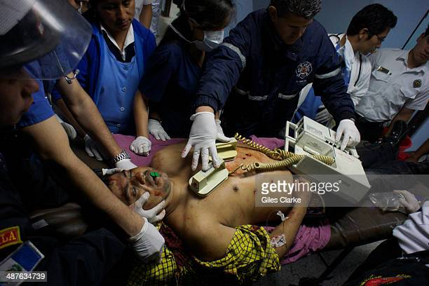 Jorge Chui the only fully qualified doctor and firefighter in the bomberos voluntarios tries to save a man who flatlines after being shot 5 times in...