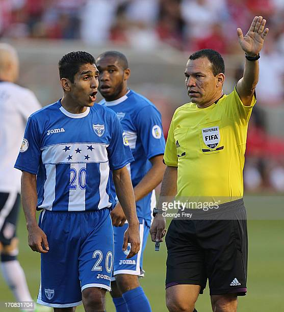 Jorge Claros of Honduras argues with an official during the second half of a World Cup qualifying match against the United States on June 18 2013 at...