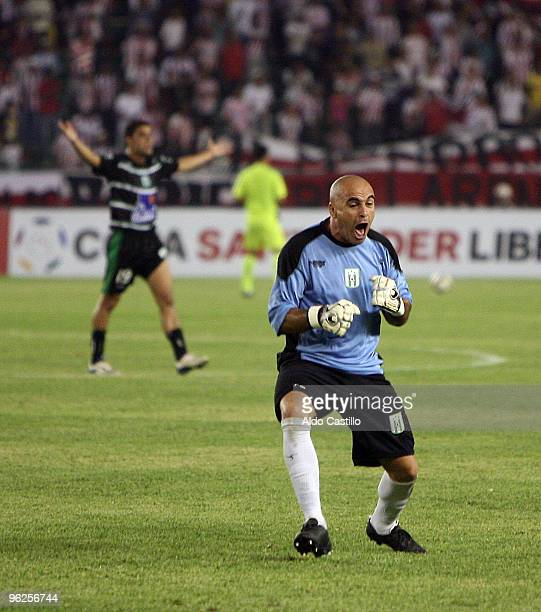 Jorge Contreras the goalkeeper of Uruguay's Racing Club celebrates a goal against Colombia's Atletico Junior during their match as part of the...