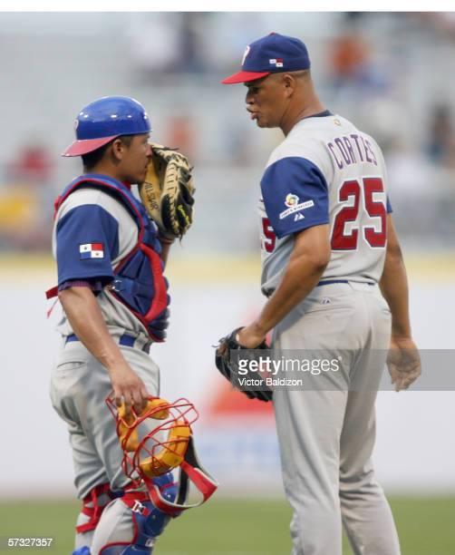 Jorge Cortez and Carlos Ruiz of Panama meet on the mound on March 8, 2006 during the game against Cuba at Hiram Bithorn Stadium in San Juan, Puerto...
