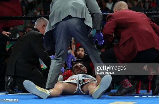 Jorge Cota is tended to by officials after being knocked out by Jermell Charlo in the third round of their super welterweight fight at the Mandalay...