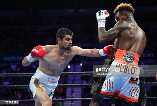 Jorge Cota lands a body blow on Jermell Charlo during their super welterweight fight at the Mandalay Bay Events Center on June 23 2019 in Las Vegas...