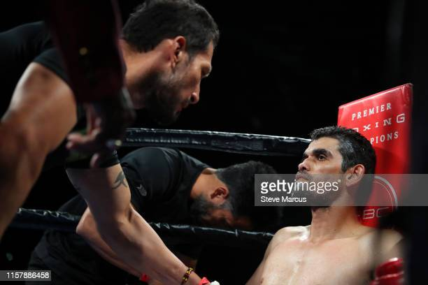 Jorge Cota listens to his trainer between rounds of a super welterweight fight against Jermell Charlo at the Mandalay Bay Events Center on June 23...