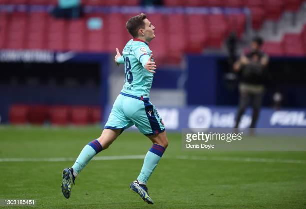 Jorge De Frutos of Levante UD celebrates after scoring their side's second goal during the La Liga Santander match between Atletico de Madrid and...