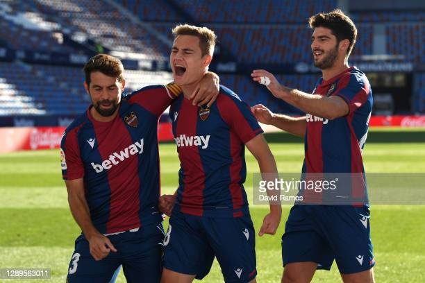 Jorge De Frutos of Levante UD celebrates with teammate Coke after scoring his team's third goal during the La Liga Santander match between Levante UD...